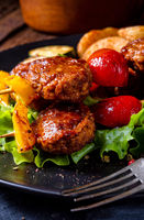 rustic Meatballs skewers of tomato, paprika and baked potato quarters