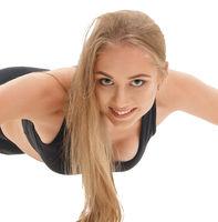 Slim sportswoman in top and leggings in studio
