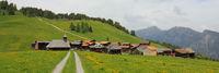 Timber church and chalets in Obermutten, Switzerland.
