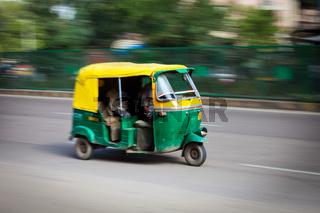 Indian auto (autorickshaw) in the street. Delhi, India