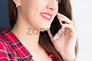 Young girl talking on phone.
