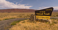 Kaibab National Forest Sign Stands Against White Clouds Blue Sky Arizona