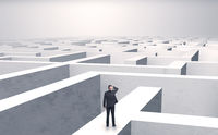 Small businessman in a middle of a maze