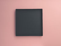Dark open box on pink paper