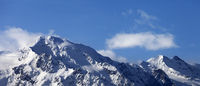 Snowy mountains at nice sunny day
