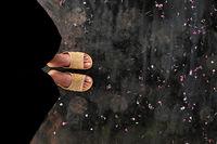 feet wear black pants, plastic sandals