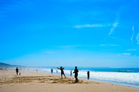 People playing beach racket Portugal