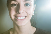 Closeup portrait of a woman and her clean and beutiful smile showing the white teeth