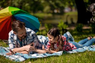 Happy family enjoying time in summer park