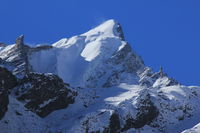 Mountain peak of the Langtang Himal range covered by glacier and snow.