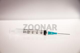 Syringe on grey background