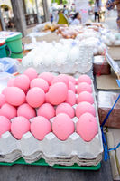 Chicken eggs painted pink for sale on market stall, Phuket, Thailand.