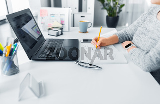 web designer working on user interface at office