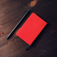 Red notepad, pencil
