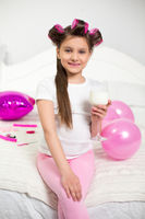Young girl with wineglass of milk.