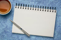 blank spiral art sketchbook with tea