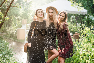 Three girls are photographed on camera