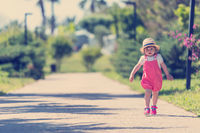 little girl runing in the summer Park
