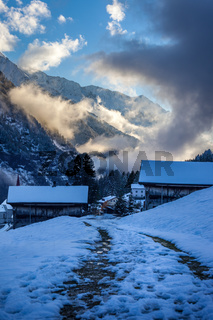 Snowy farm houses at the blue hour