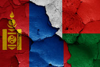 flags of Mongolia and Madagascar painted on cracked wall