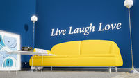 orange sofa in a blue room live laugh love