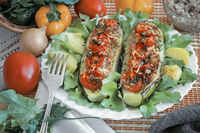 Stuffed with minced meat zucchini on a plate.