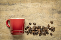 espresso cup and coffee beans abstract