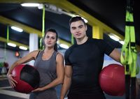 young athletes couple working out with medical ball