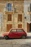 Old vintage car in front of typical traditional house in Valletta in Malta