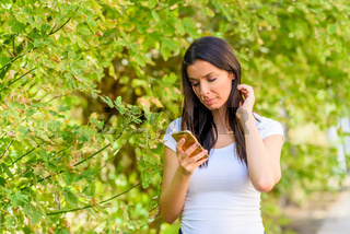 A woman receiving bad news on her Smartphone