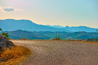 Road bend and panoramic view of Thessaly valley