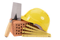 house construction with brick, tools,  plan and model house