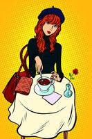 Red haired girl in a cafe