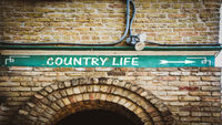 Street Sign to Country Life