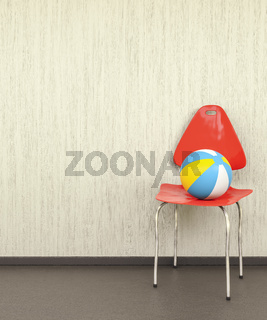 red chair at a wall with a ball