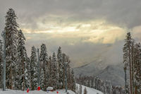 Cloudy and misty weather on ski resort