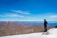 Man admiring the winter beauty of Lovcen NP