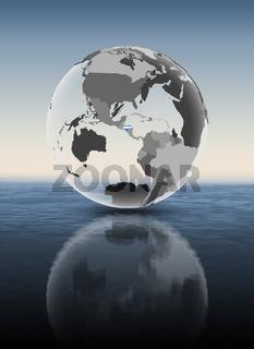 Honduras on translucent globe above water