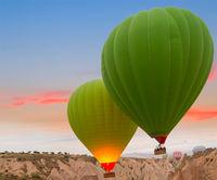 Hot air balloons rock landscape