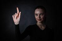 Woman pointing at virtual display