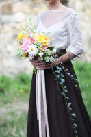 Young bride holding beautiful bouquet
