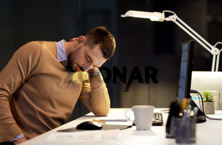 tired man having neck ache working at night office