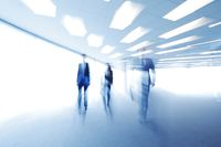 Blurred image of business people walking