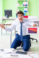 Frustrated businessman stressed from excessive work