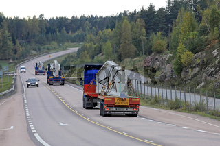 Fleet of Long Transports on Highway