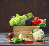 Organic raw vegitables in wooden box. Healthy diet and nutrition concept