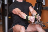 Close up Strong man training in gym dorsal top train.