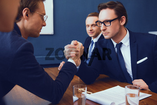Business armwrestling in office