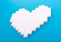 Heart of sugar cubes, blue background