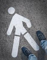 Man near at the pedestrian road sign